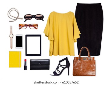 Still life of business clothing and accessories for woman on isolated white background.