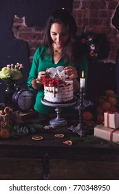 still life cake girl decorates cake with gingerbread