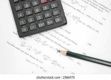 Still life of an calculator and a pencil on scientific paper