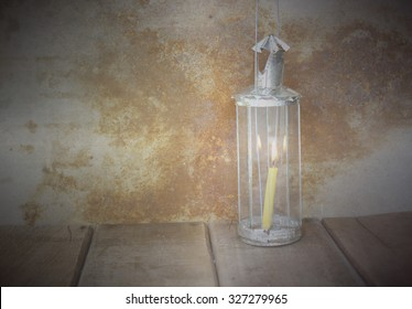 Still Life, Candle in Vintage lamplight on wooden table