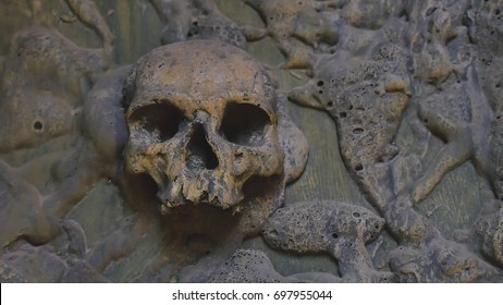 Still life Cannibal Cave photography with six of human skulls and bones in genocide concept