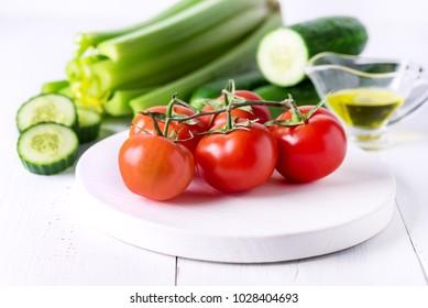 Still life Celery Tomatoes Cucumber Olive Oil Ripe Vegetables Ingredients foe Healthy Tasty Salad