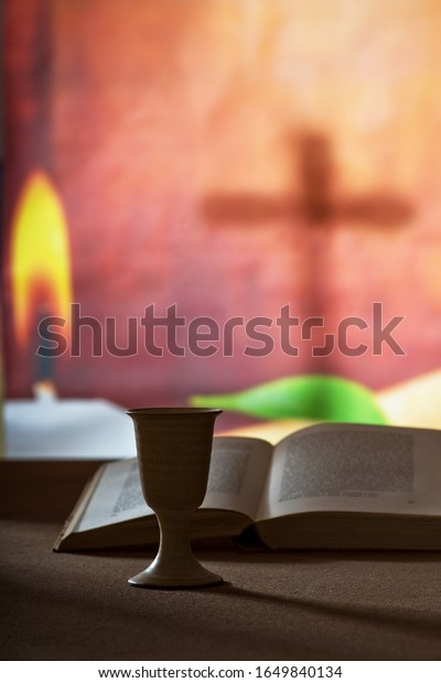 Still life with chalice of wine and open bible