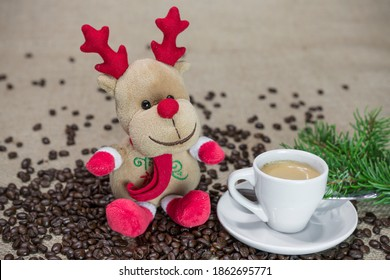 Still life christmas with a reindeer and a cup of coffee