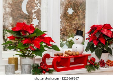 still life at christmas with snowman and sled