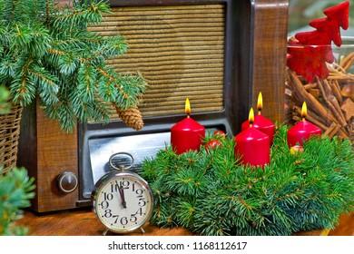 Still life with Christmas wreath and alarm clock