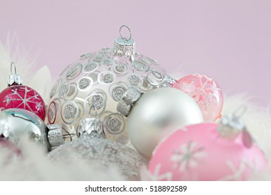 Still life close up of luxury decorative christmas bauballs together with plain purple background, round textured objects, indoors. Xmas occasion spirit decorations, shiny in interior space, backdrop.