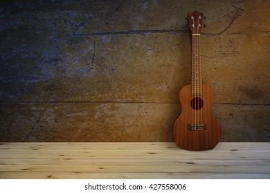 Still life, Close up of ukulele on old wooden background