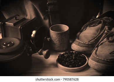 still life with coffee beans and Coffee grinder on the wooden background