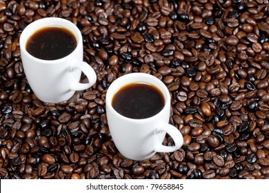 still life of coffee cups and coffee beans