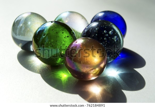 Still life of colorful marbles in soft light