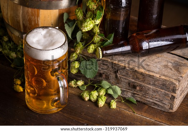 Still life composition with glass and bottle of fresh beer