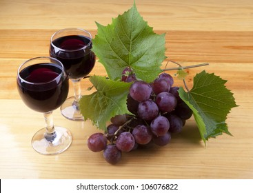 A still life composition with grape and wine.