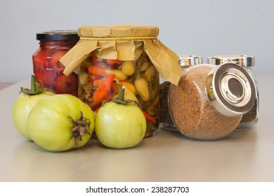 Still life composition with pickle, spice and green tomatos