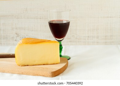 Still life composition with red wine and homemade rustic cheese