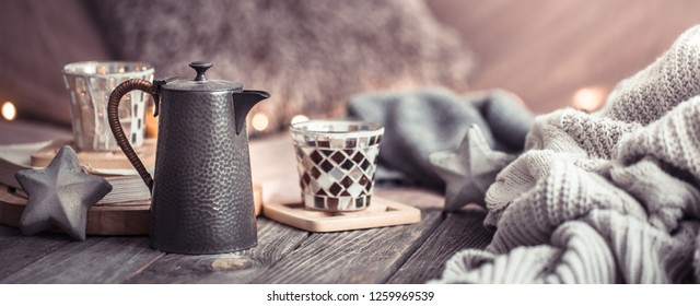 Still life cozy home, interior details in the living room on a wooden table, the concept of home comfort and care