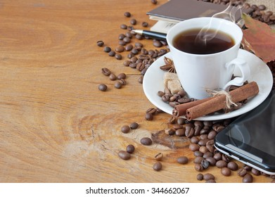 Still life with cup of hot coffee, coffee beans, clock. Coffee time. Vintage picture