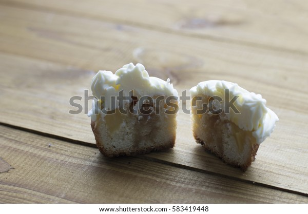 still life of cupcakes cut in half on a wooden tray