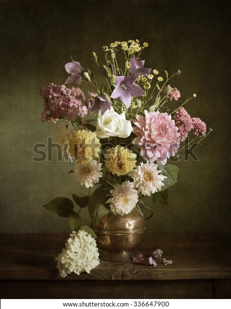 Still life with dahlias in a copper vase (textured for artistic effect)