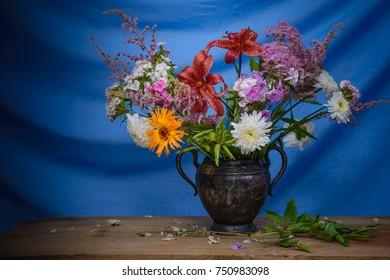 Still life decorative- flower beautiful bouquet. Drapery background.