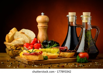 still life with delicious traditional spanish tapas snacks