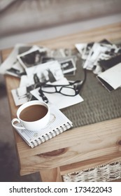 Still life details, cup of coffee and retro vintage black-and-white photos