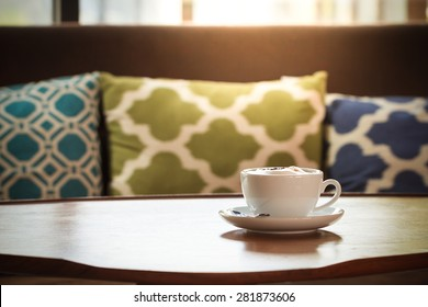 Still life details, cup of coffee on wood table