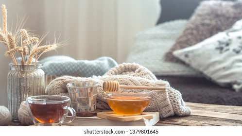 Still life details of home interior on a wooden table with a Cup of tea, the concept of coziness and home atmosphere .Living room