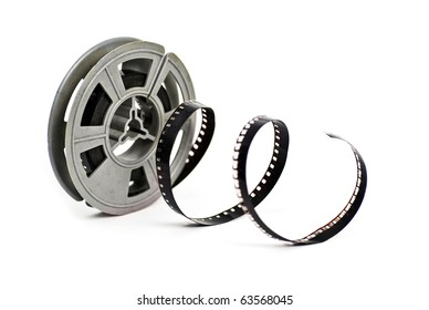 still life of dirty, old 8mm cine film and reel; isolated on white ground
