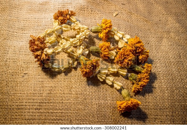 still life of Dried flower garland in Thai style. on Sackcloth