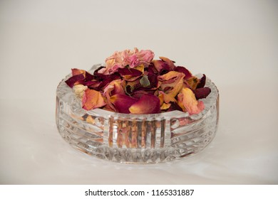 still life: dried petals of roses in a glass ashtray