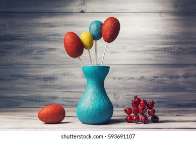 Still life with easter decorative eggs over wooden background