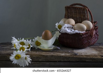 Still life with eggs, bread and cheese