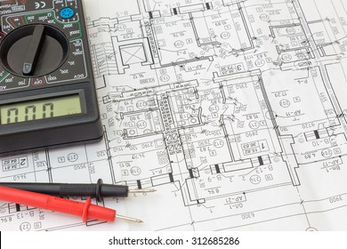 Still Life Of Electrical Components Arranged On Plans. Centered
