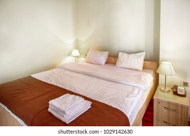 Still life of an empty bed in a hotel bedroom with soft cushions Horizontal 1cf1c3534