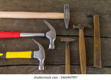 Still life flat lay made of hammers old vs new