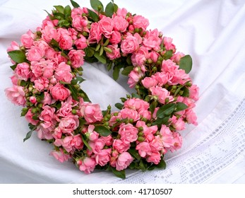Still life with floral wreath of roses