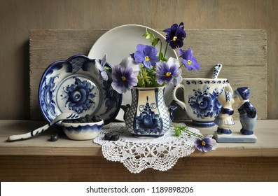 Still life with flowers and traditional Russian dishes in the style of Gzhel