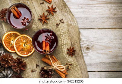 Still life, food and drink, seasonal and holidays concept. Christmas mulled wine on a rustic wooden table. Selective focus, copy space background, top view
