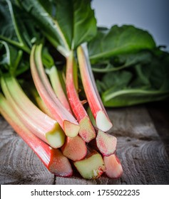 still life with fresh rhubarb on a wooden background