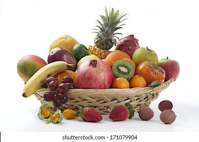 Still life of fruit in basket isolated on white  background