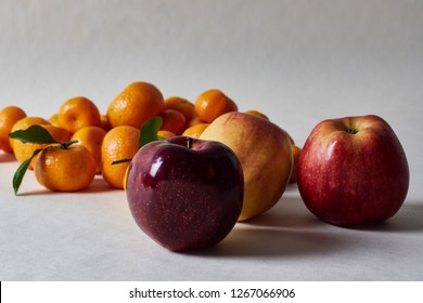 still life, fruit composition of mandarins, apples, lying on a white background