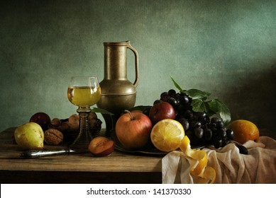 Still life with fruit and a glass of wine