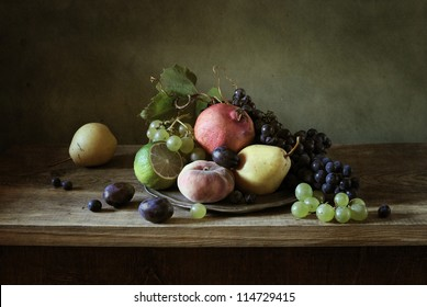Still life with fruit in a silver plate