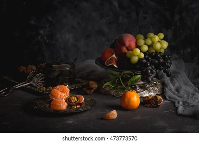 Still life. Fruits in a beautiful vase. Vintage crockery.