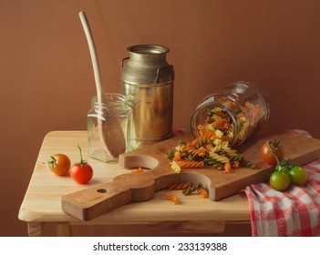 Still life with fusilli pasta and tomatoes