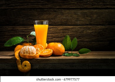 Still Life Glass of Fresh Orange Juice on Vintage Wood Table with Copy Space Background