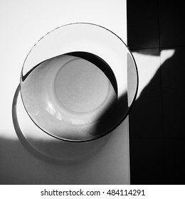 Still life with a glass plate on white table