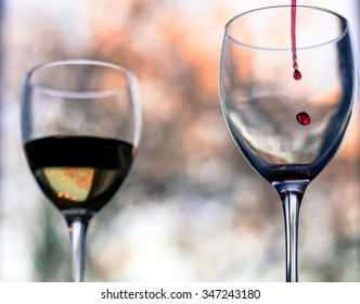Still life with glass of wine on isolated background