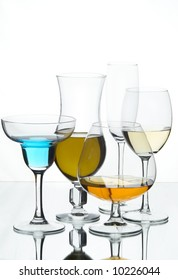 Still life with glasses with drink on the white background;